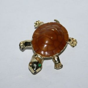 Vintage gold turtle brooch with green eye